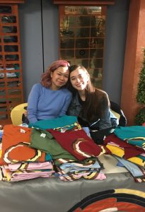 Claire and Bronwyn manning the Racial Unity merch table