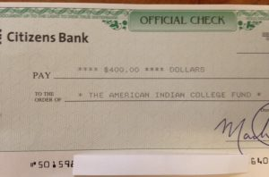 Donation check to the American Indian College Fund